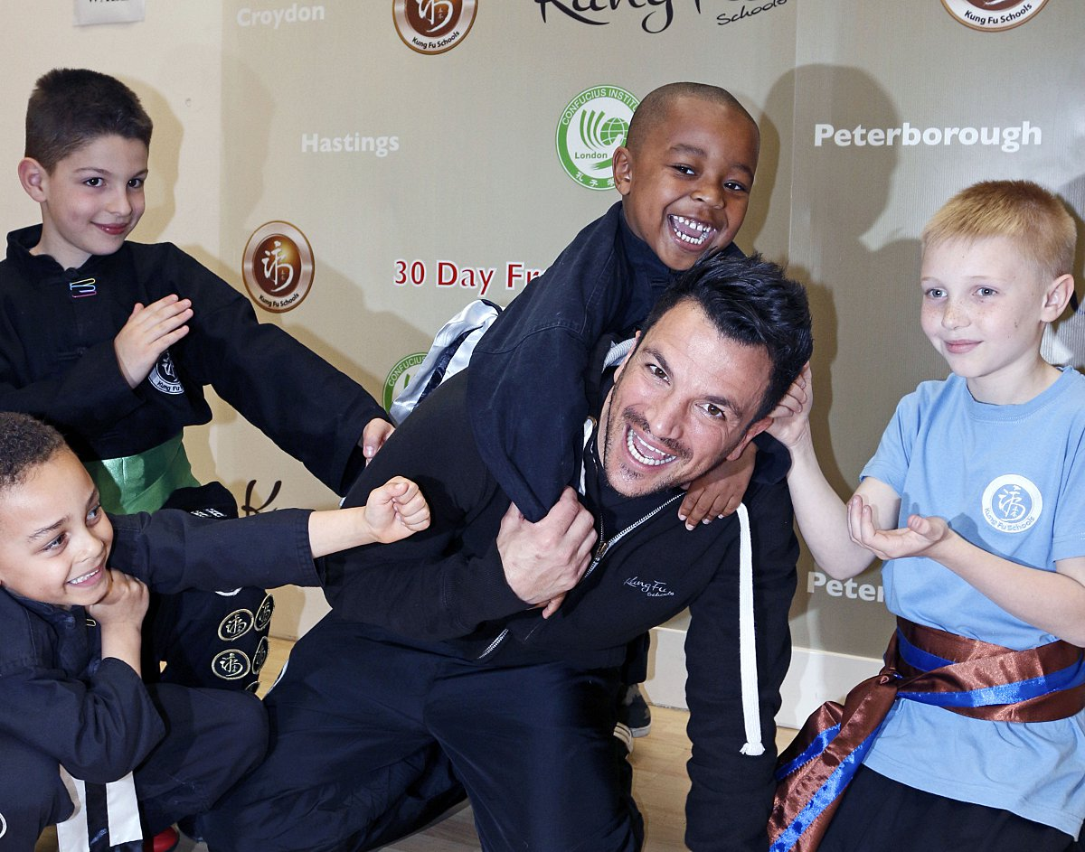 Peter Andre was 'attacked' by the top fundraisers in Croydon: Louie Wright, 5, Lucas Walker, 7, Kyle Kerr, 5, and 10-year-old Joshua Stratton