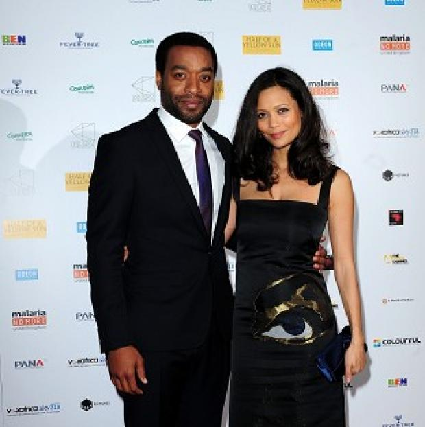 This Is Local London: Chiwetel Ejiofer (left) and Thandie Newton attending the premiere of Half of A Yellow Sun at the Odeon Streatham, London.