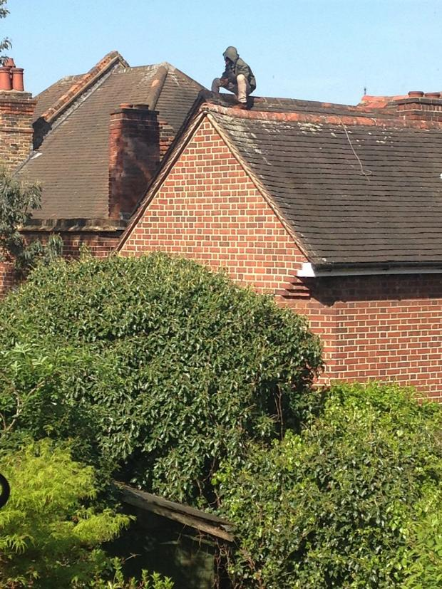 This Is Local London: The man on the roof this morning, picture courtesy of Edward Parker Humphreys