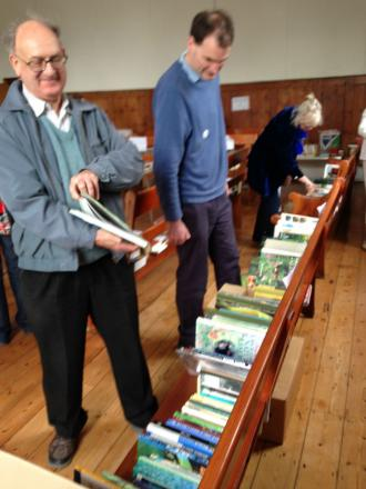 A group of Quakers check out what books are on offer.