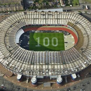 An aerial image of a giant 100 which has been painted on the grass at Hampden Park to mark 100 days to go until the Com