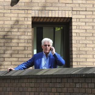 This Is Local London: Publicist Max Clifford makes a phone call during a break in his trial at Southwark Crown Court
