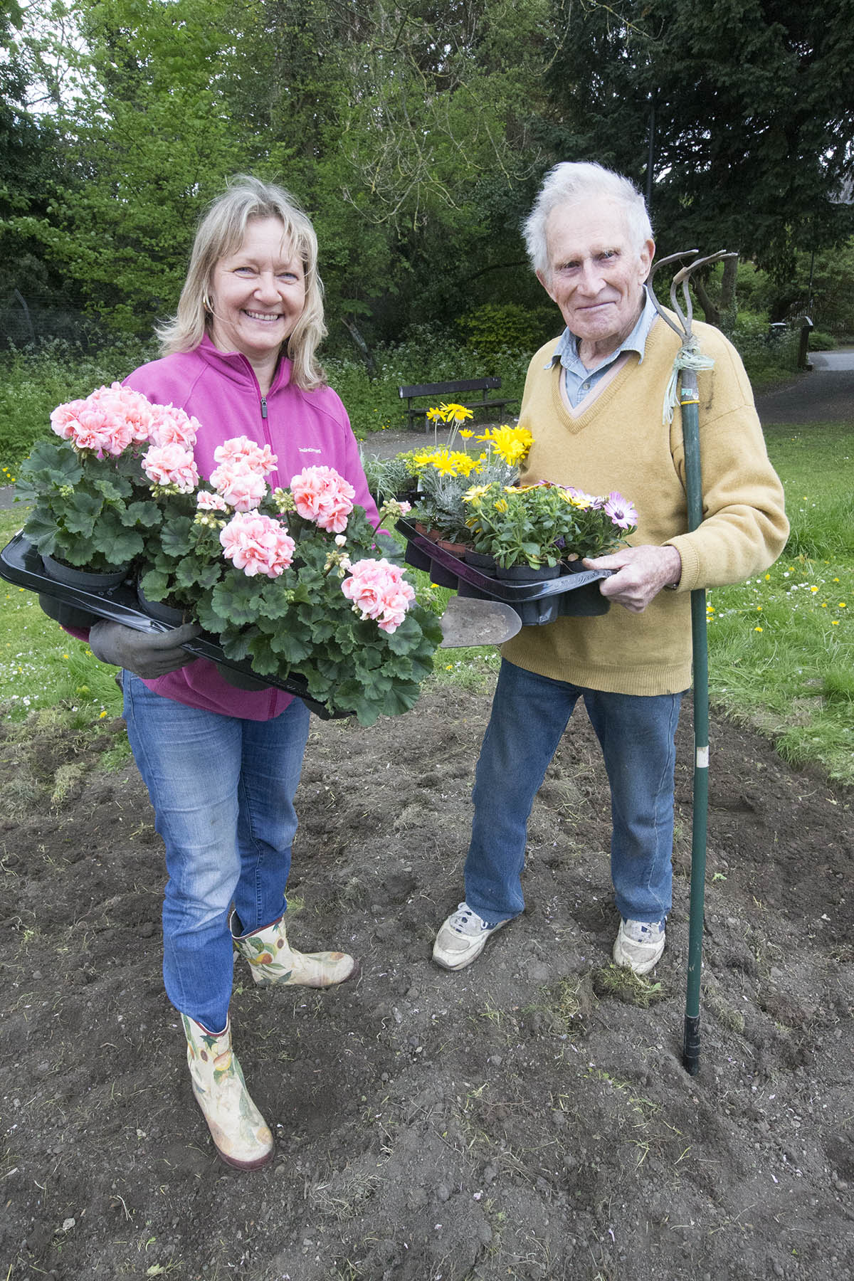 Ted Bamford plants new flower beds to make village pretty again with help from neighbour Eva Barnes