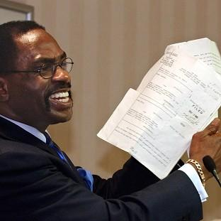 "This Is Local London: Former boxer, Rubin ""Hurricane"" Carter,  holds up the writ of habeas corpus that freed him from prison"