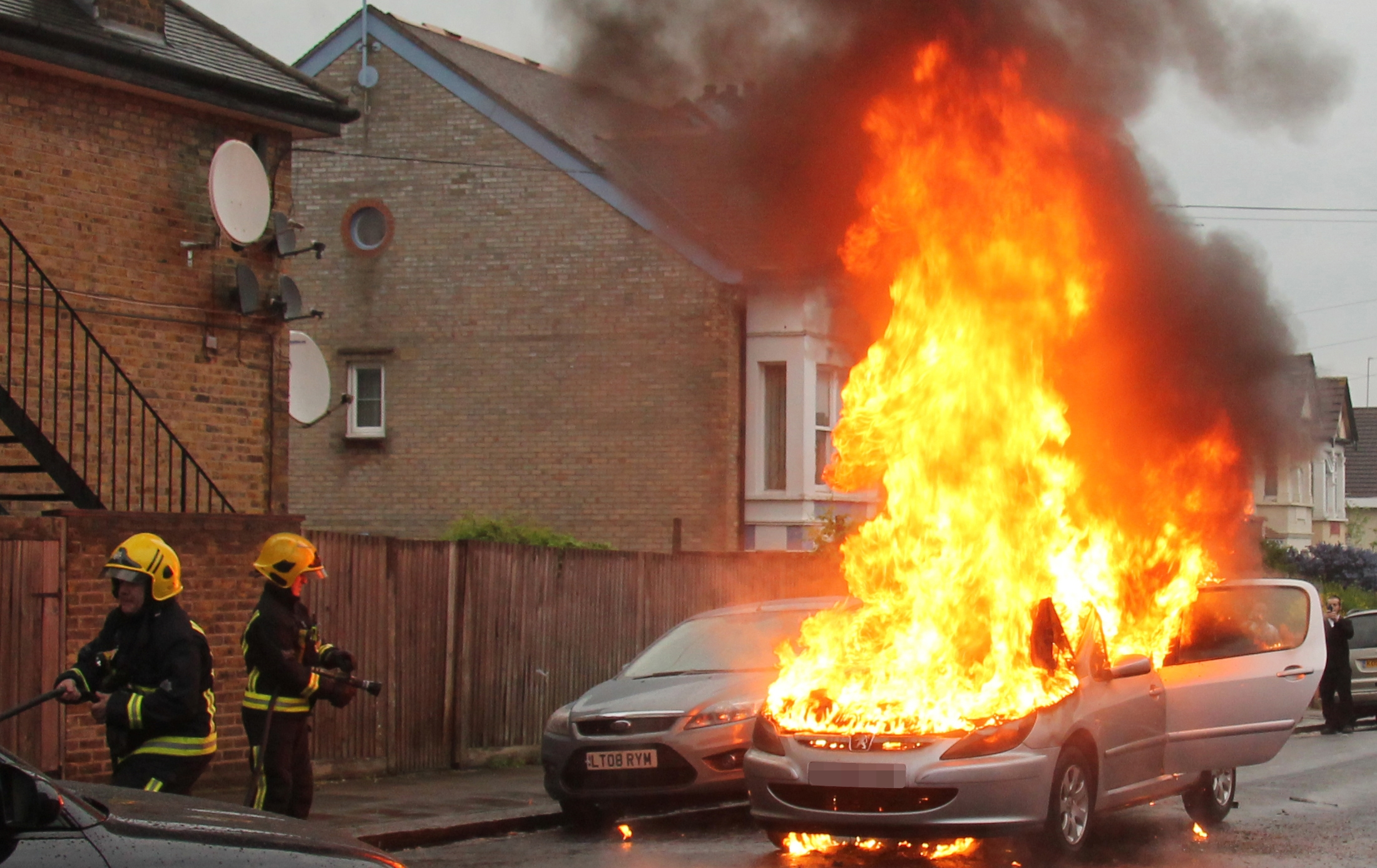 Firefighters arrived within minutes to extinguish the flames after the baby and the elderly man had been pulled from the car