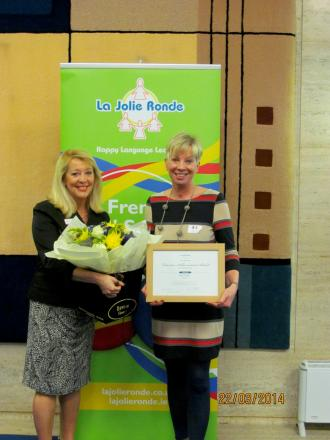 Great work: Joy Jermy (right) receiving her 20 year service award from Colette Hallam, founder of La Jolie Ronde