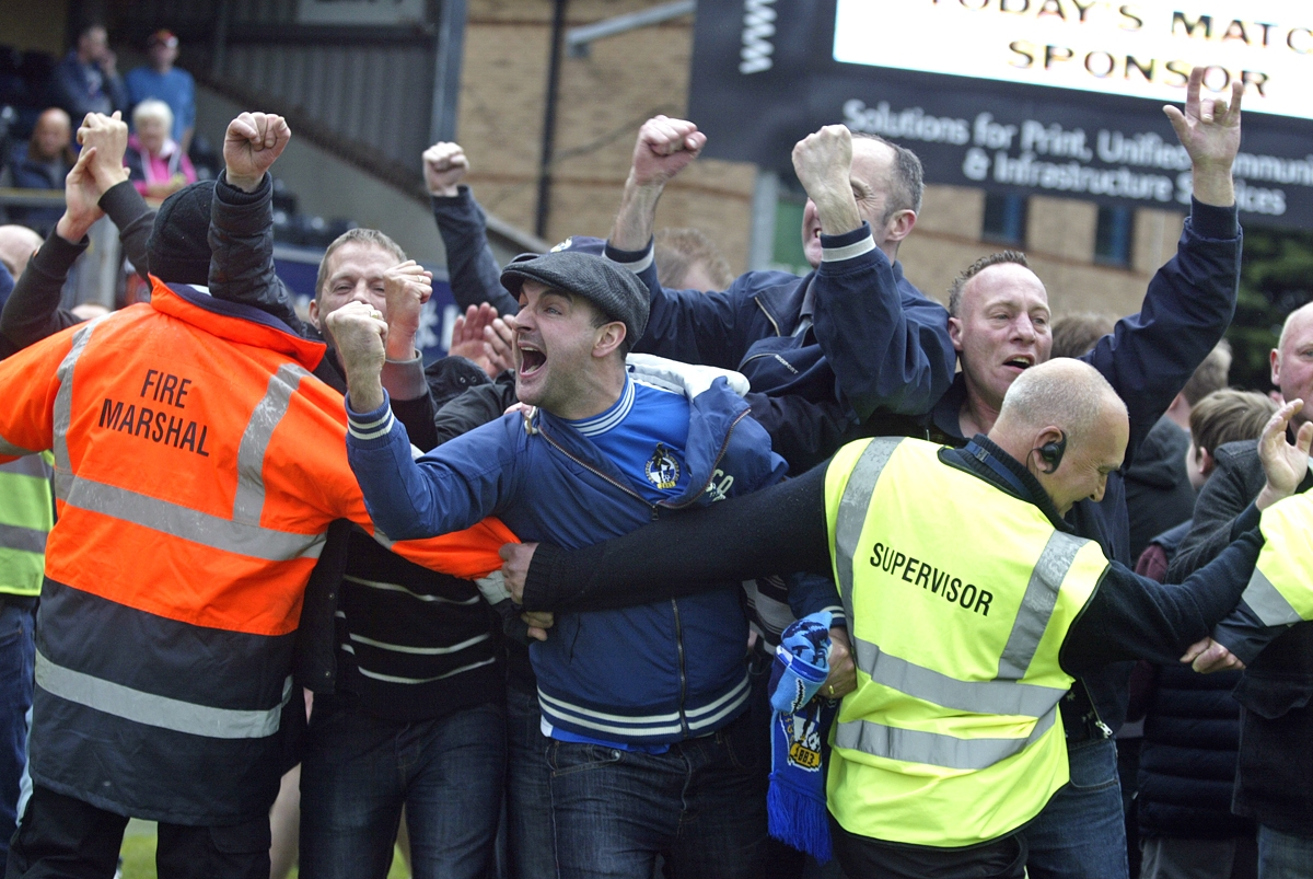 Bristol Rovers fans invaded the Adams Park pitch during and after Saturday's game with Wanderers