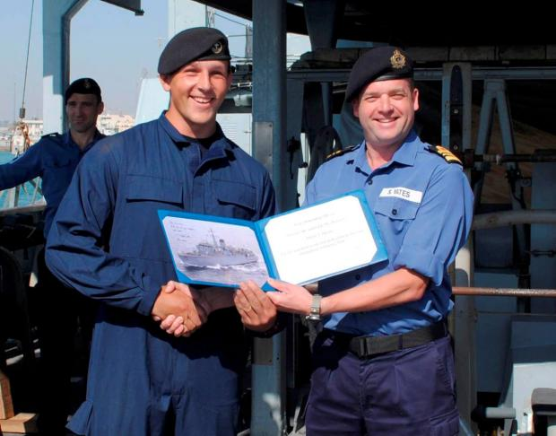 Award: Able seaman diver Tom Davies is presented with the sailor of the month award by HMS Quorn's Commanding Officer Lieutenant Commander Stuart Yates