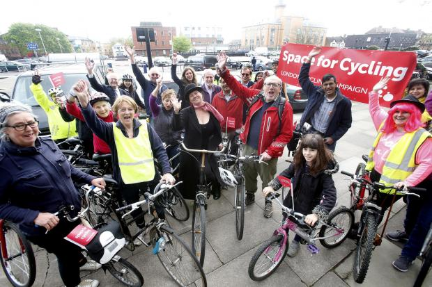 Cyclists ride together as part of London campaign
