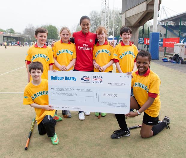 Rachel Yankey passed over the cheque to students from Muswell Hill