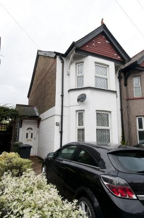 The house in Hook Road, Epsom, where the stabbing took place
