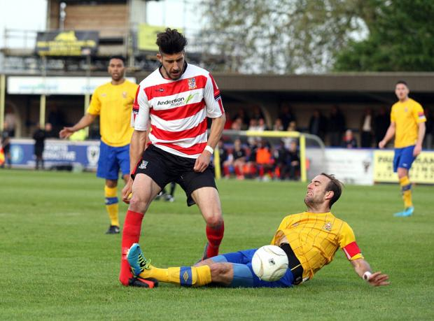 Staying put: Kingstonian midfielder Daniel Sweeney in action during last season's play-off semi final defeat to AFC Hornchurch