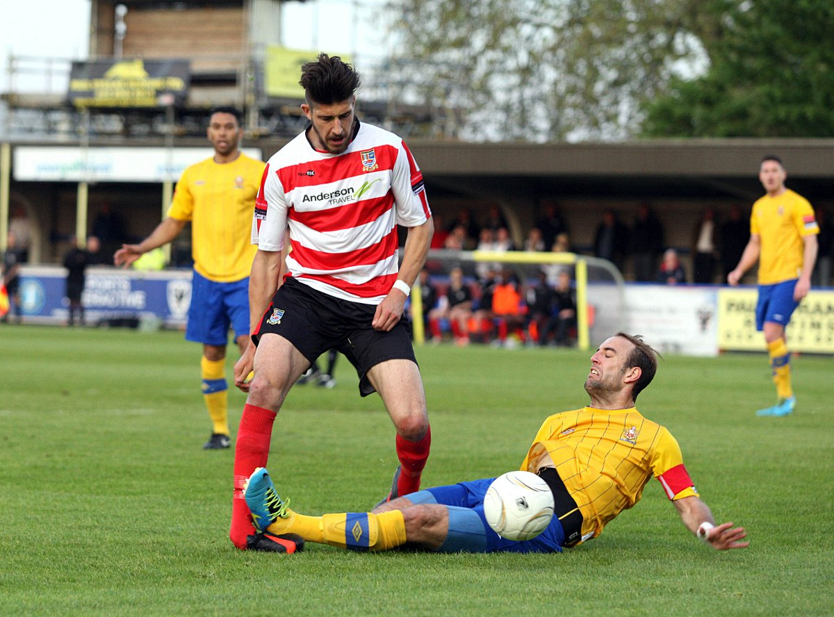 Ouch: Ks midfielder Daniel Sweeney is felled by AFC Hornchurch skipper Elliott Styles in the first half. Penalty claims were waved away and Sweeney hobbled off following the incident that boss Alan Dowson felt was key to h