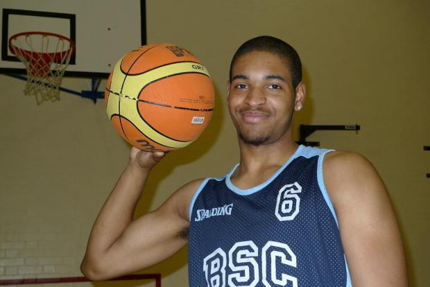 Teenager one step closer to basketball dream with scholarship
