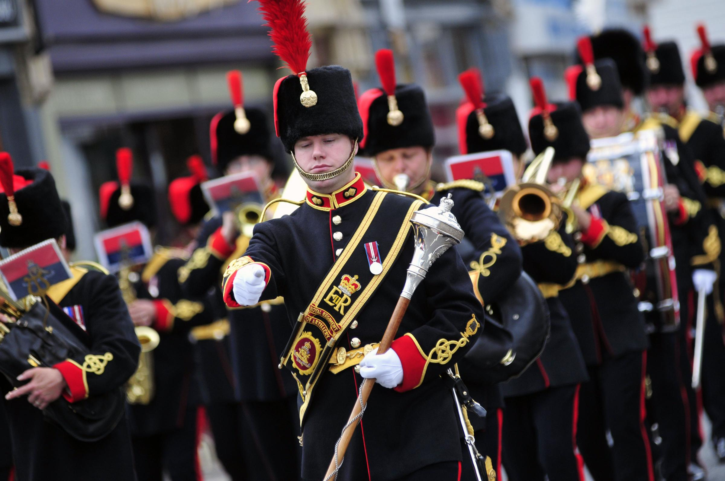 Band and soldiers march through Epsom in 2012 to mark its 75th anniversary