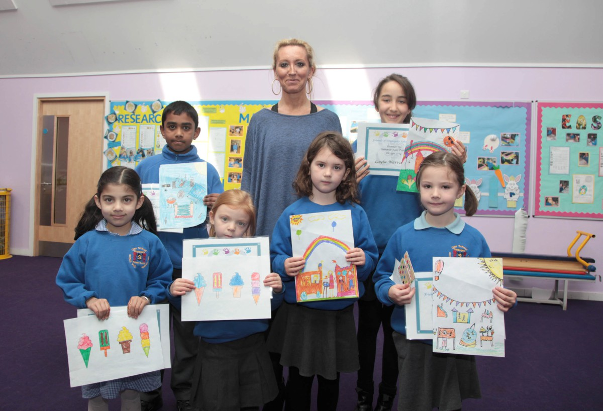 Headteacher Nathalie Bull with youngsters and their artwork