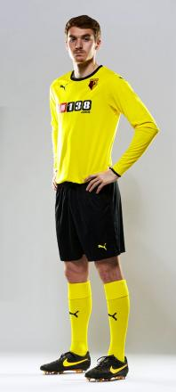 Tommie Hoban wearing the black shorts version of Watford's new home kit
