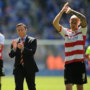 This Is Local London: Doncaster Rovers manager Paul Dickov and members of the team applaud the travelling fans after the game against Leicester City