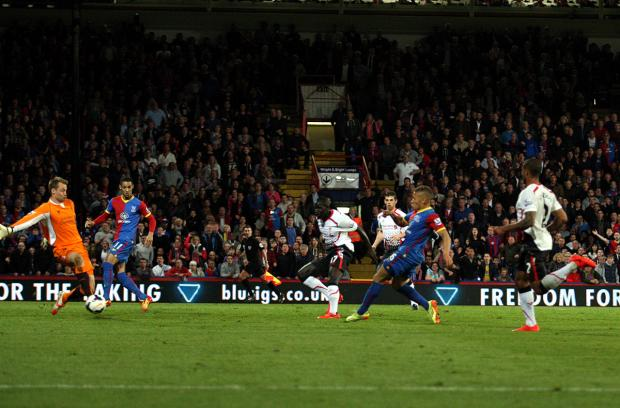 This Is Local London: Dwight Gayle slips the ball under Simon Mignolet to make it 3-3. Pictures by Edmund Boyden.