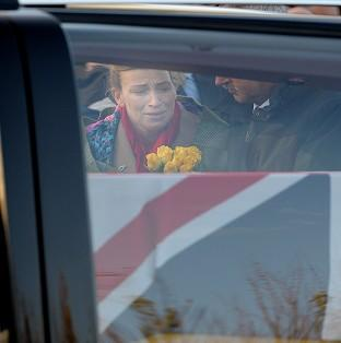 This Is Local London: Emma Fisher, the widow of Warrant Officer Class 2 Ian Michael Fisher, as the cortege passes