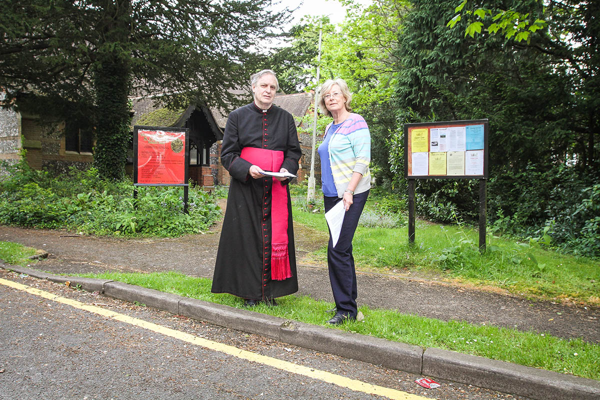 Father Clive Pearce and parish administrator Gillian Whitehead are gathering a petition calling for a review of the restrictions