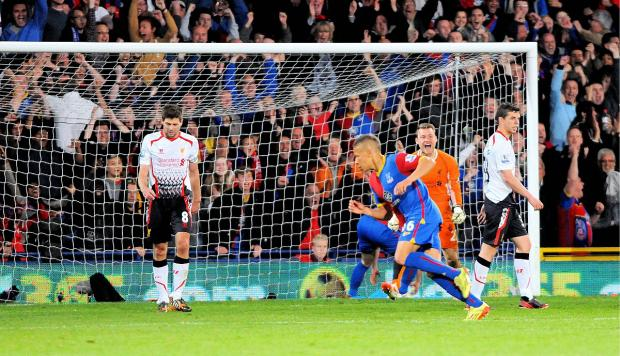 Impact: Dwight Gayle puts Liverpool on the rocks at Selhurst Park                   Picture: David Purday
