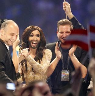 This Is Local London: Austria's Conchita Wurst, who performed the song Rise Like a Phoenix, listens as points are announced at the final of the Eurovision Song Contest in Denmark (AP)