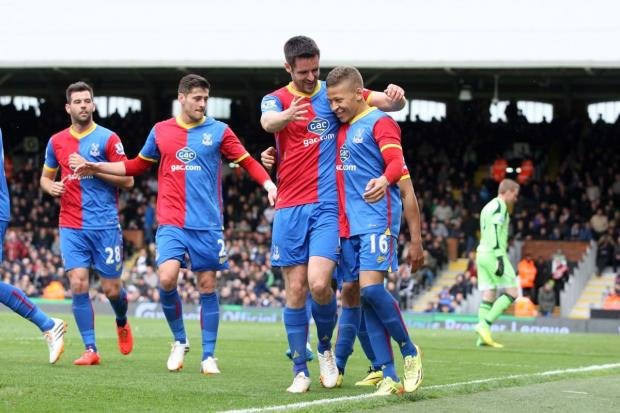 Celebration time: Dwight Gayle and his team-mates enjoy the new-found camaraderie after his goal against Fulham