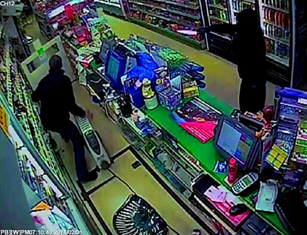 This Is Local London: Terrifying: CCTV from McCluskey's shows Ogunbanwo brandishing a knife