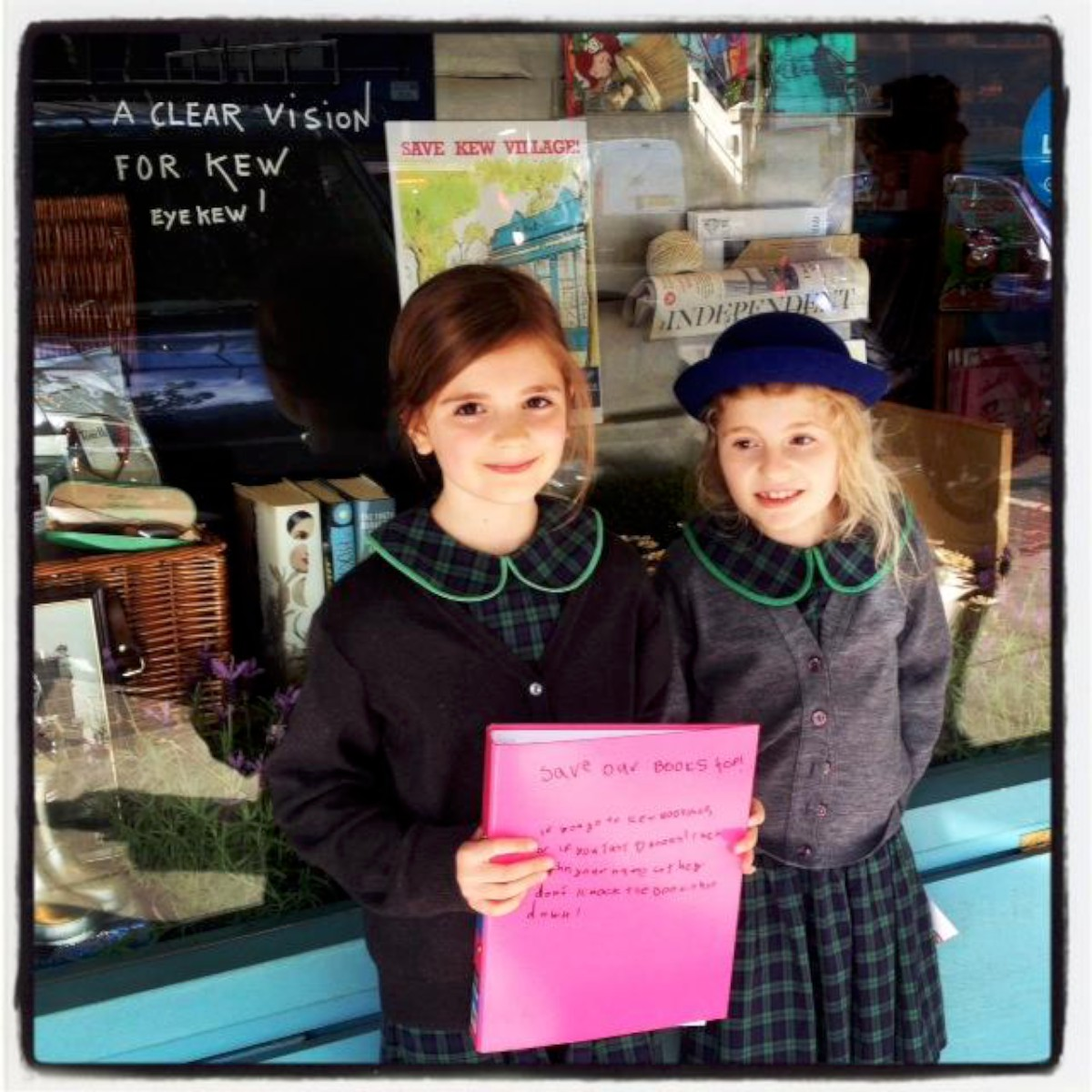 Getting involved: Spencer Shaw, 7, and  Isla Shaw, 9, outside Kew Bookshop