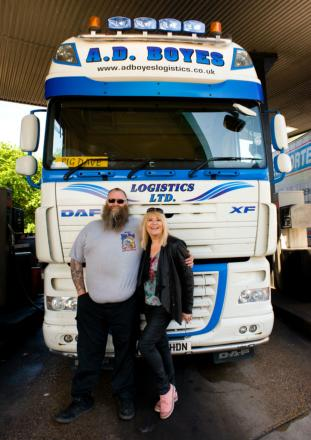 Sally Traffic poses for a picture with a lorry driver in South Mimms