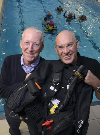 Roger Bacon, the soldier's father, and Ray Peck, from the scuba club