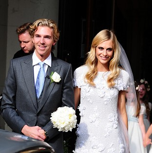 James Cook and Poppy Delevingne after their wedding at St Paul's Church in Kensi