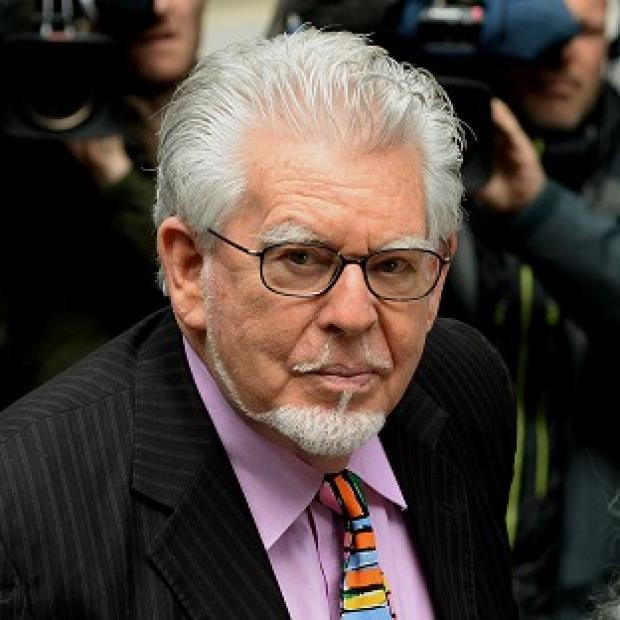 This Is Local London: Rolf Harris denies the charges.