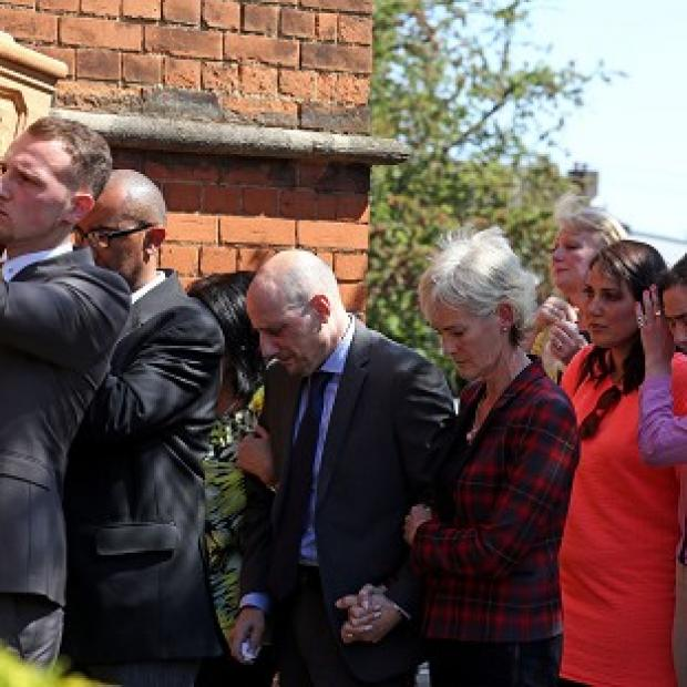 This Is Local London: Judy Murray with Nino Severino follows the coffin of former tennis player Elena Baltacha into church.