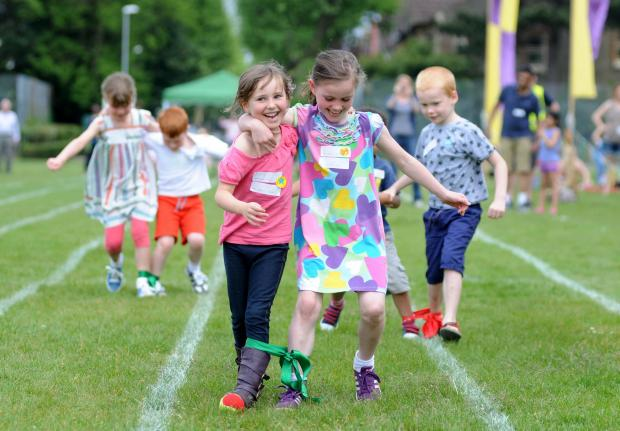 Sophie Welsh, five and Susannah Welsh, eight, finish second in the three-legged race