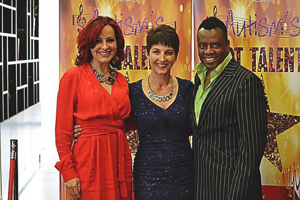 Anna Kennedy OBE, centre, with Carrie and David Grant.