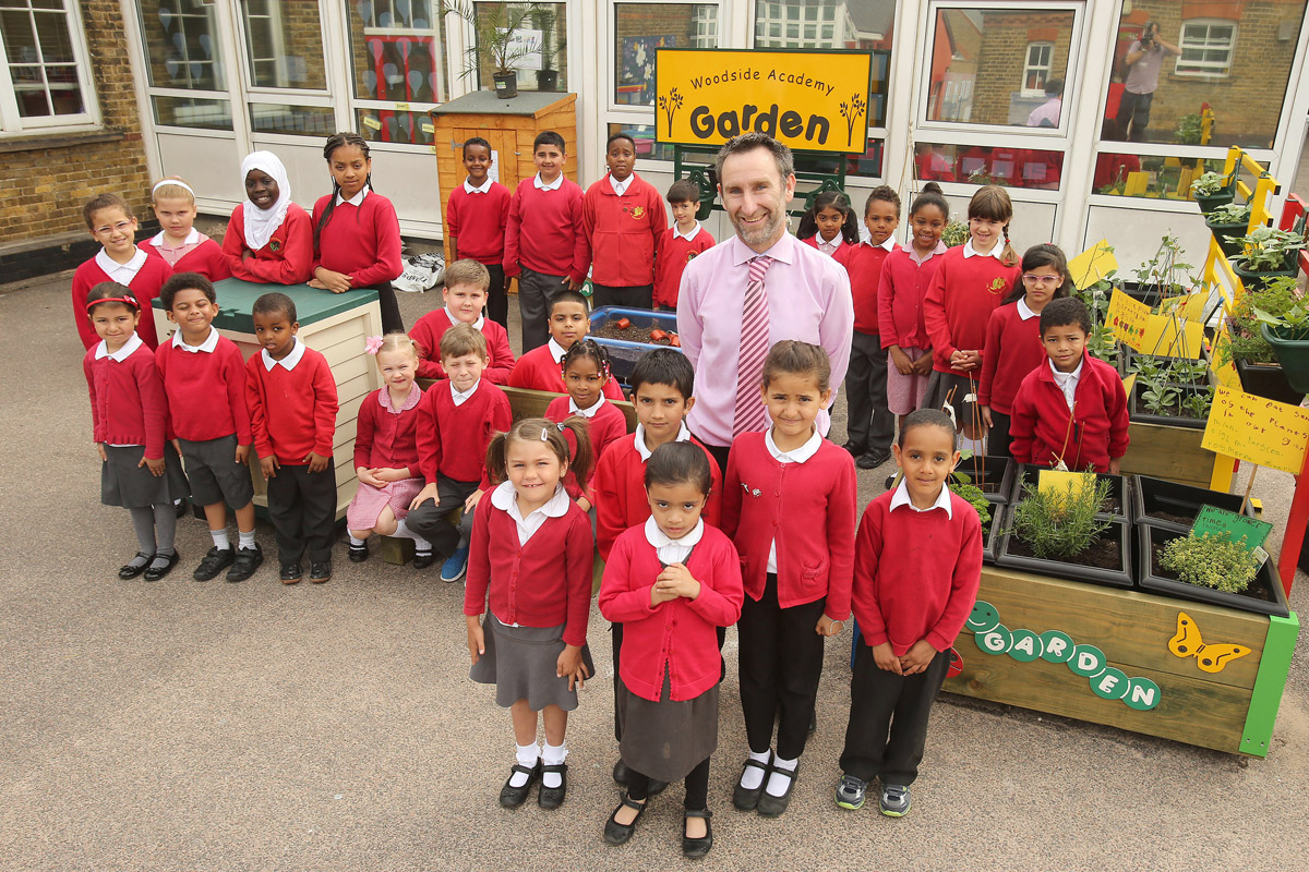 Headteacher Shane Tewes and children at Woodside Primary Academy.