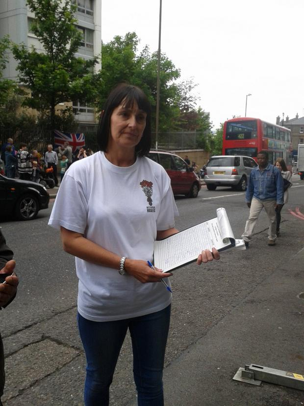 This Is Local London: Lorna Taylor holding her petition for a permanent memorial to Lee Rigby in Woolwich