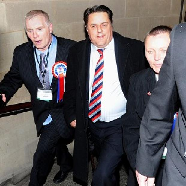 This Is Local London: BNP leader Nick Griffin (centre) arrives at the European Parliamentary elections count at Manchester Town Hall