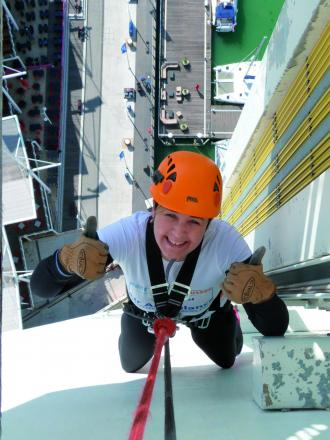 Abseiler raises £3,000 for air ambulance that saved her husband's life