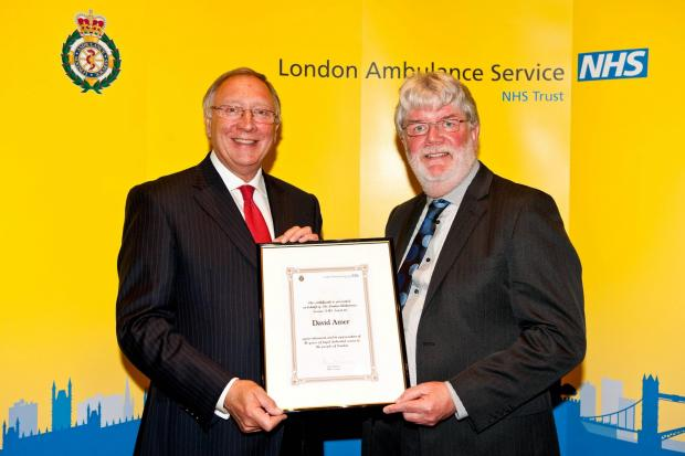 This Is Local London: Amublanceman David Amer, 60, (right) being presented with a commendation by ambulance service chairman Richard Hunt