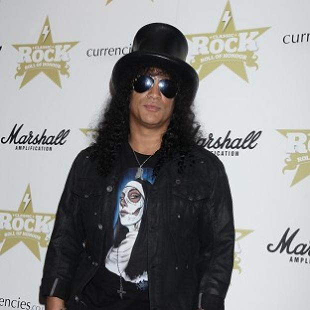 This Is Local London: Slash performed at a Spotify session