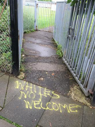 Whites not welcome graffiti