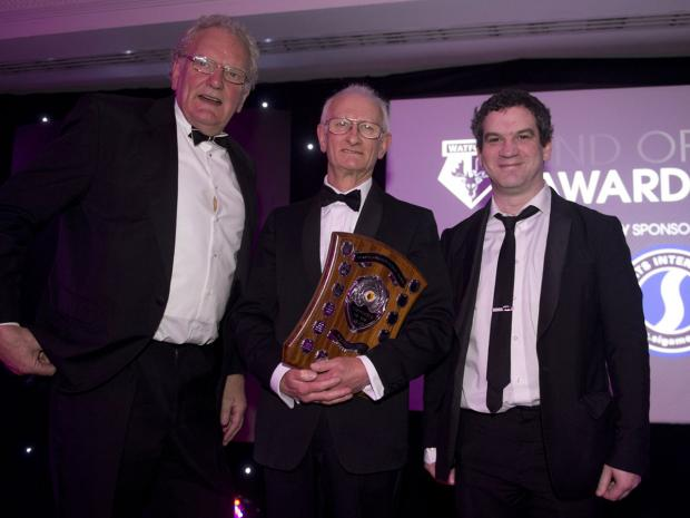 Oliver Phillips, left, with Trefor Jones, centre, and Miles Jacobson from award sponsors Sports Interactive. Picture: Alan Cozzi/Watford FC