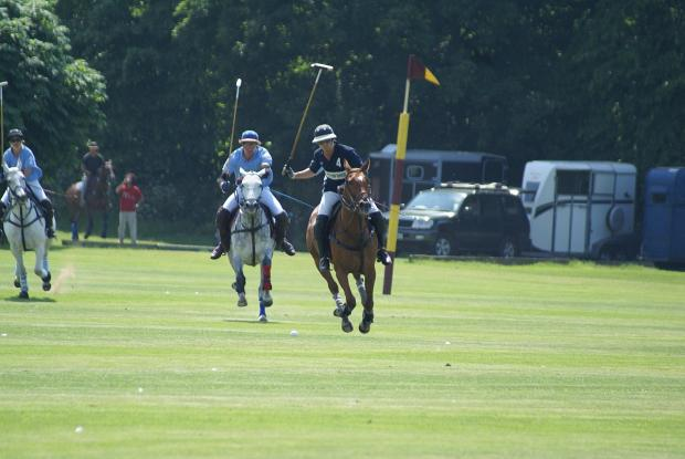 This Is Local London: On the charge: Cavaliers star Benjie Davis, light blue, gives chase as Charlie Wood launches an attack for Quadriga in the Ham House Trophy final    Picture Stuart Amos