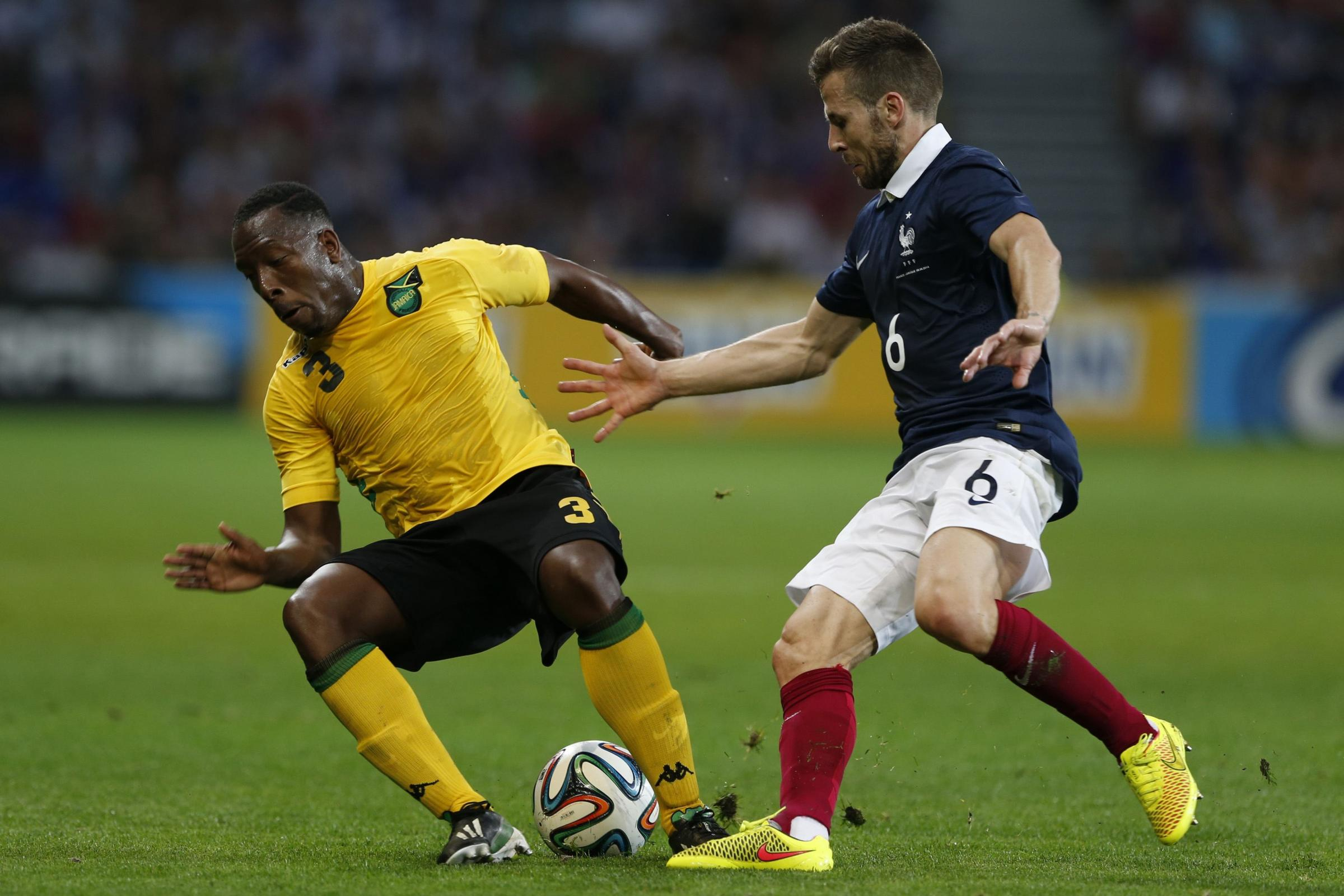 Lloyd Doyley does battle with PSG midfielder Yohan Cabaye. Picture: Action Images