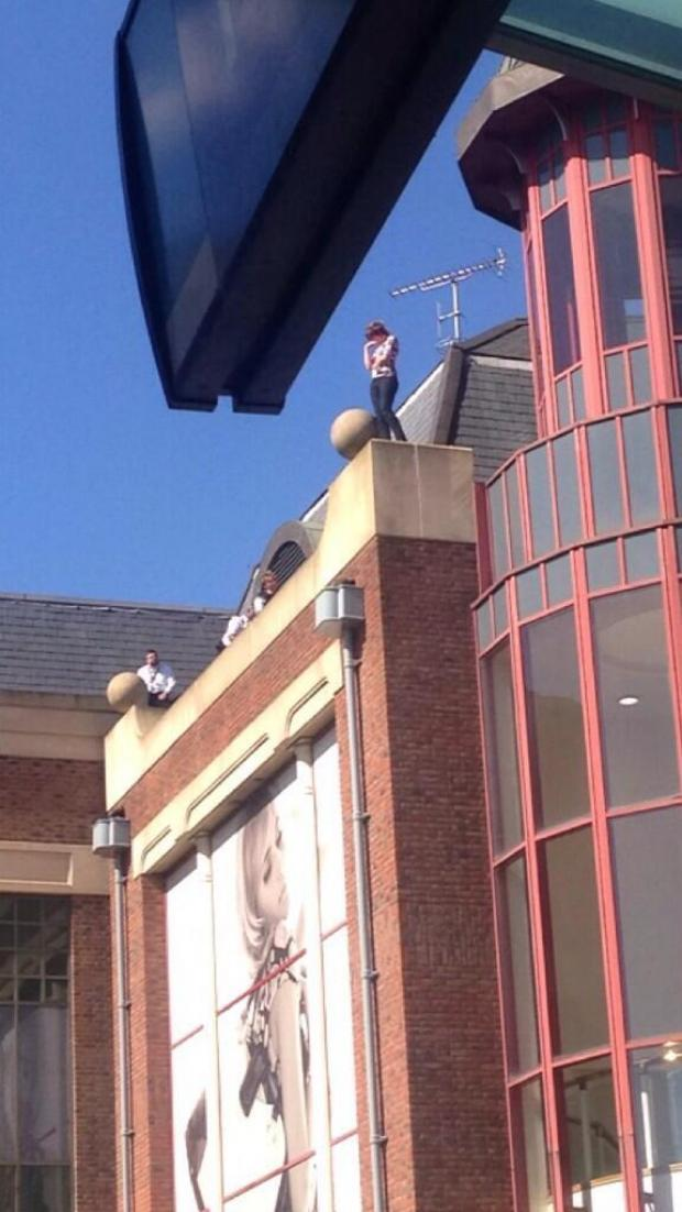 This Is Local London: The woman stands on the roof of intu Bromley's car park. Photo: @Kent_999