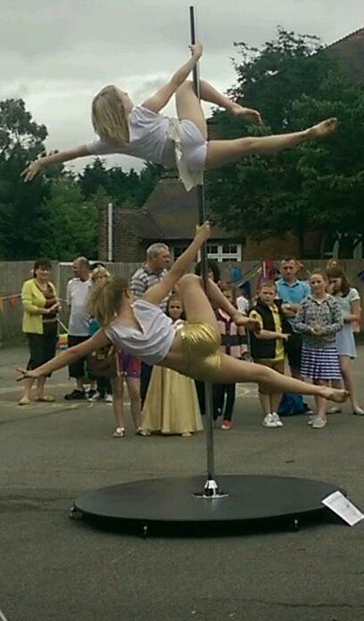 VIDEO: Watch pole-dance display at school fete branded 'sleazy' for involving girls as young as 4