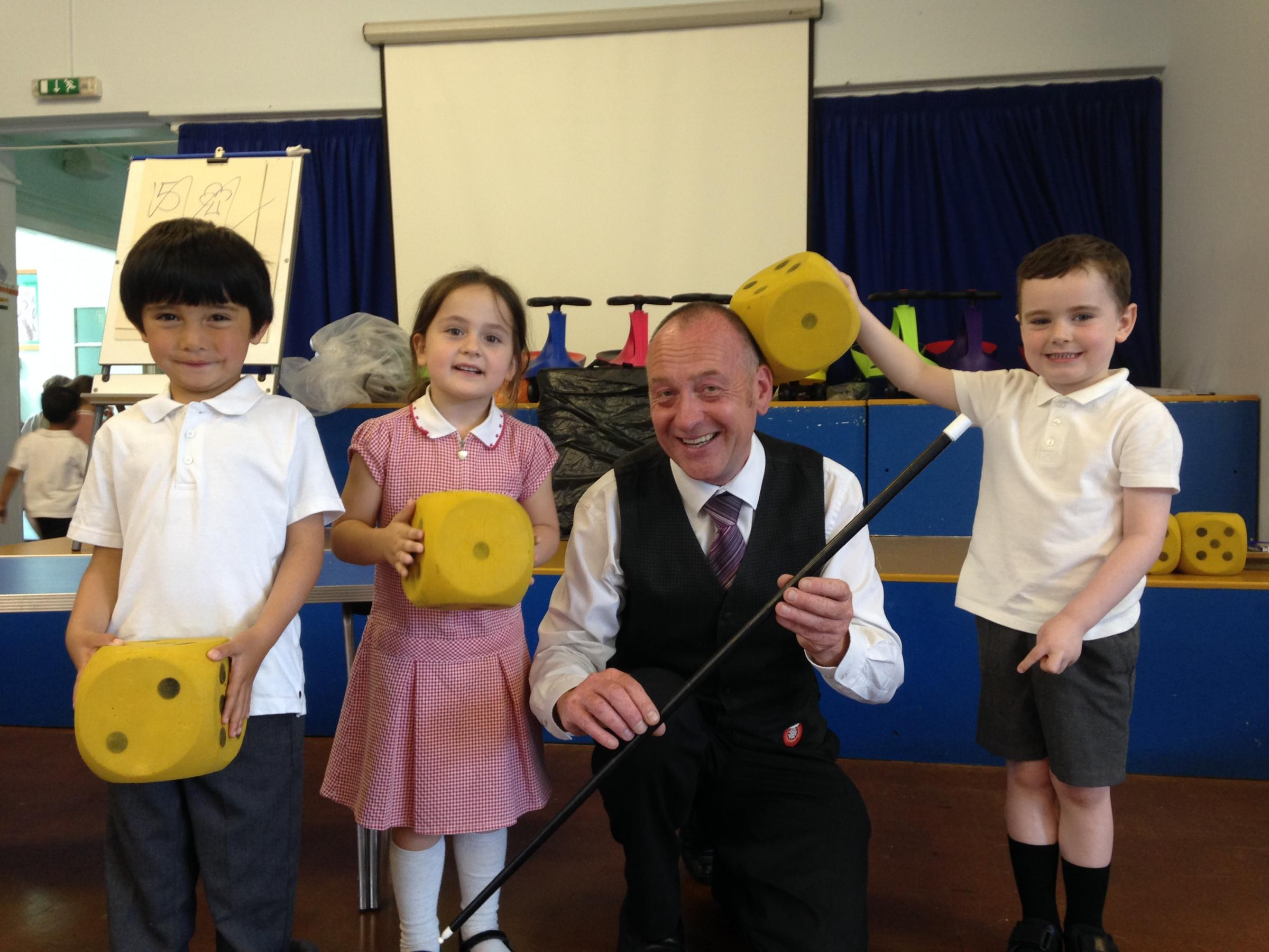 Add-bracadabra: Magician Tony Charles with pupils (from left) Julian Tanca, Amelie Bull and Hayden Lowey